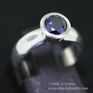 Blue Sapphire Tapered Bezel Ring